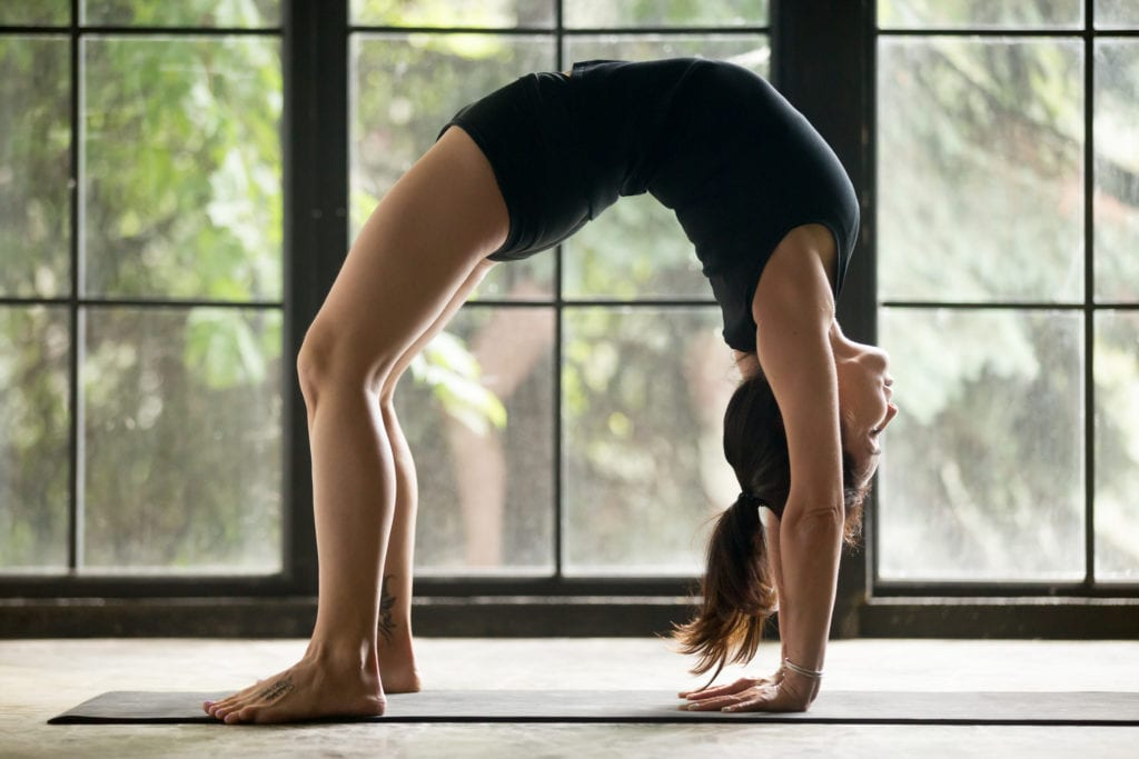 Young attractive woman in Bridge pose